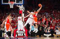 NEW YORK, NY - Sunday December 13, 2015: Amar Alibegovic (#1) of St. John's, left, and Malachi Richardson (#23) of Syracuse fight for a rebound.  St. John's defeats Syracuse 84-72 during the NCAA men's basketball regular season at Madison Square Garden in New York City.