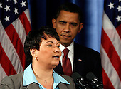 Chicago, IL - December 15, 2008 -- United States President-elect Barack Obama (R) listens to Lisa Jackson, (L) his nominee to run the Environmental Protection Agency (EPA), during a news conference in Chicago, Illinois on Monday, December 15, 2008. .Credit: Jeff Haynes / CNP