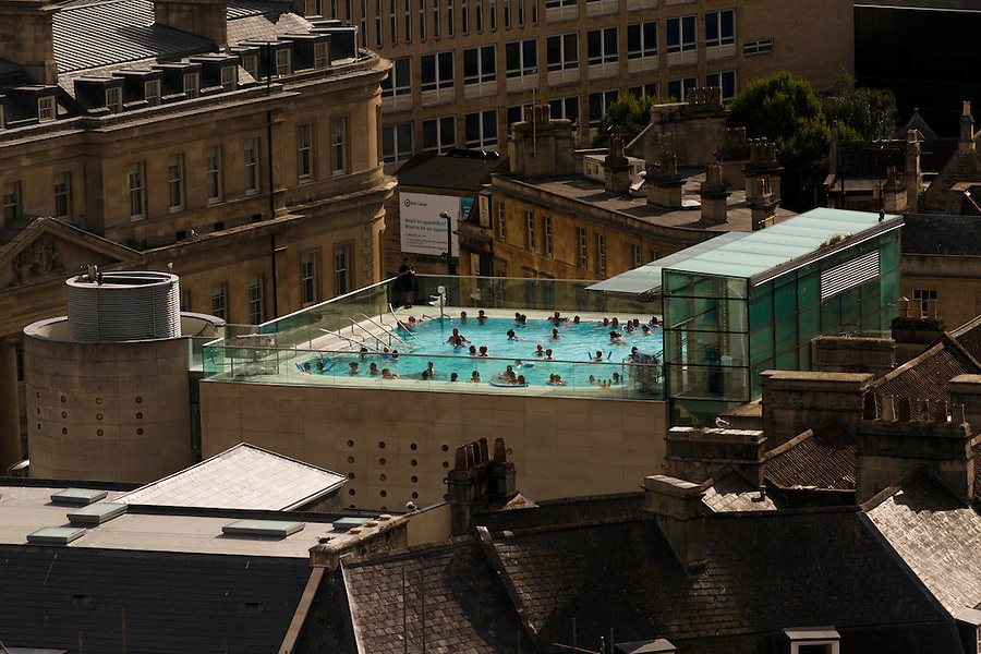The rooftop Bath of the Thermae Bath Spa, Bath, UK, July 10, 2015. The UNESCO World Heritage city of Bath is famed for its hot spa that dates back to Roman times and for its Georgian architecture. For much of its history the city has been a popular holiday resort. It is the only hot spa in the UK.