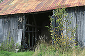Old barn used to store round bales of hay,