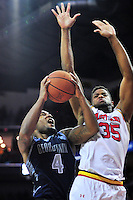 D'Vauntes Smith-Rivera of the Hoyas goes up strong the basket against Terrapins Damonte Dodd. Maryland defeated Georgetown 75-71 during a game at Xfinity Center in College Park, MD on Wednesday, November 17, 2015.  Alan P. Santos/DC Sports Box