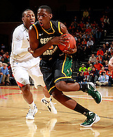 CHARLOTTESVILLE, VA- DECEMBER 6: Jonathan Arledge #5 of the George Mason Patriots drives past Akil Mitchell #25 of the Virginia Cavaliers during the game on December 6, 2011 at the John Paul Jones Arena in Charlottesville, Virginia. Virginia defeated George Mason 68-48. (Photo by Andrew Shurtleff/Getty Images) *** Local Caption *** Jonathan Arledge;Akil Mitchell