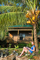 Kampung Air Batang, Pulau Tioman Island, Malaysia, October 2010.  ABC Chalets are situated in on of the most beatiful coves on the island. Tioman Island is a tropical island paradise off the east coast of Malaysia. Independent tourists come here to relax on the palm fringed beaches, for diving and snorkeling or for trekking through the rainforest. Photo by Frits Meyst/Adventure4ever.com