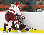 Danny Biega (Harvard - 9), Robbie Bourdon (Colgate - 17) - The Harvard University Crimson defeated the visiting Colgate University Raiders 6-2 (2 EN) on Friday, January 28, 2011, at Bright Hockey Center in Cambridge, Massachusetts.