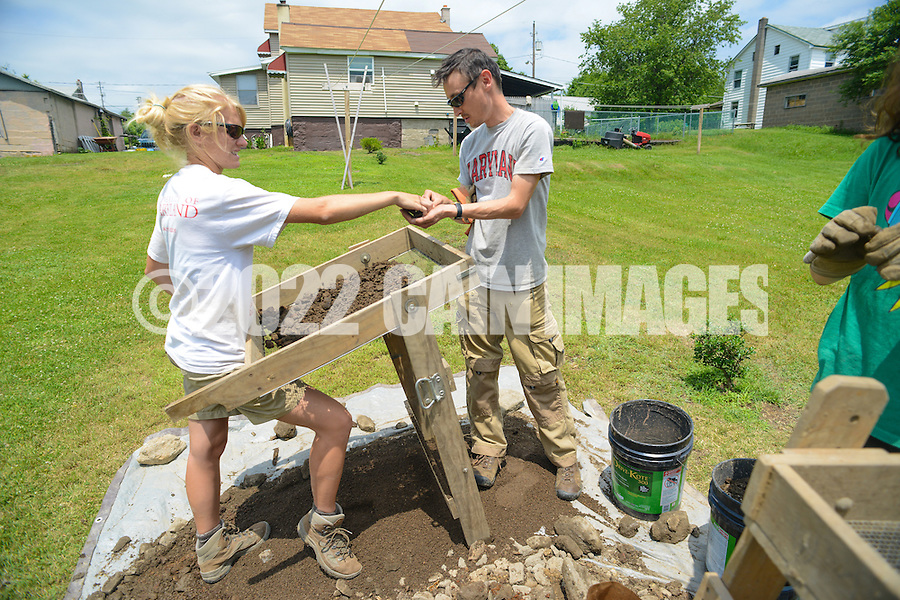 HAZLETON, PA - JUNE 30:  Camille Westmont (L) and Mike Roller work at the site of an archaeologic dig June 30, 2014 in Hazleton, Pennsylvania. The team is looking through sites connected with the Lattimer Massacre which occurred in 1897. (Photo by William Thomas Cain/Cain Images)