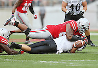 Ohio State Buckeyes defensive lineman Michael Bennett (63) forces a fumble as he sacks San Diego State Aztecs quarterback Quinn Kaehler (18) during the second quarter of the NCAA football game against San Diego State at Ohio Stadium in Columbus on Sept. 7, 2013. (Adam Cairns / The Columbus Dispatch)