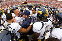 California head coach Jeff Tedford huddles with his players after warm-ups before going into the locker room at LA Memorial Coliseum in Los Angeles, California.  USC defeated California, 48-14.