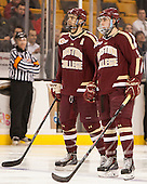 Isaac MacLeod (BC - 7), Brendan Silk (BC - 9) - The Boston College Eagles defeated the Boston University Terriers 3-1 (EN) in their opening round game of the 2014 Beanpot on Monday, February 3, 2014, at TD Garden in Boston, Massachusetts.