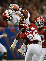 Photo by Gary Cosby Jr.    Oklahoma wide receiver Derrick Woods makes a dramatic catch over Alabama defensive back Landon Collins during the first half of the Sugar Bowl in the Superdome in New Orleans.