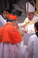 South Korean cardinal Andrew Yeom Soo Jung  receives his beret as he is being appointed cardinal by Pope Francis  at the consistory in the St. Peter's Basilica at the Vatican on February 22, 2014.