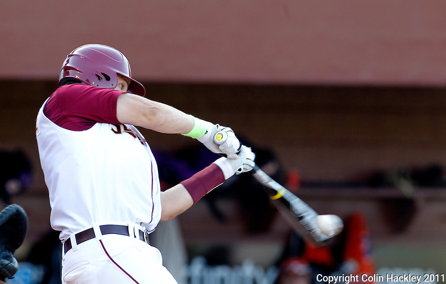 TALLAHASSEE, FL 5/20/11-FSU-CLEMBASE11 CH-Florida State's Parker Brunelle hits but is thrown out at first base during second inning action against Clemson Friday at Dick Howser Stadium in Tallahassee. The Seminoles lost to the Tigers 4-7..COLIN HACKLEY PHOTO