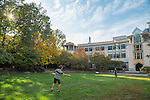 Students throw around a frisbee in a courtyard outside the  Levine Science Research Center on a crisp Fall day.