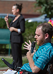 David McNelly, front, a member of the Athens County Board of Developmental Disorders, talks while Kaitlyn Finneran, back, a staff interpreter from the Deaf Services Center in Worthington, Ohio, signs during the ADA25 Kickoff Event on October 6, 2015 at Ohio University's Howard Park. McNelly talked about Friends, Allies, and Neighbors of Athens County, a group that helps people with disabilities get involved in the community, and his experiences with accessibility. Photo by Emily Matthews