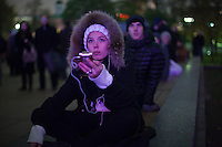 Moscow, Russia, 28/10/2011..A woman records the music during the Bolshoi Theatre reopening gala while watching the performances on giant outdoor video screens on Ploschad Revolutsii, where crowds gathered to watch the reopening of the theatre.  It had had been closed since 2005 for reconstruction work that cost some $700 million.