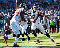 The Carolina Panthers defeated the Atlanta Falcons 34-10 in an inter-division rivalry played in Charlotte, NC at Bank of America Stadium.  Atlanta Falcons quarterback Matt Ryan (2) hands the ball off to Atlanta Falcons running back Steven Jackson (39)