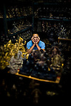 A Bangkok merchant naps amid a large inventory of Buddhist deity statues.