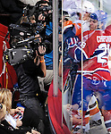 26 October 2009: Video cameras capture close checking along the glass during a game between the Montreal Canadiens and the New York Islanders at the Bell Centre in Montreal, Quebec, Canada. The Canadiens defeated the Islanders 3-2 in sudden death overtime for their 4th consecutive win. Mandatory Credit: Ed Wolfstein Photo