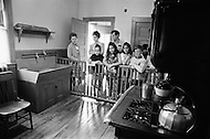 June 1970, Brookline, Massachusetts, <br /> Visitors look at the kitchen of the J.F. Kennedy Birthplace Historic Site, the three story house in Brookline in which US President John F. Kennedy was born. After JFK's death, the Kennedy family bought back the house at 83 Beals Street from the then owners and turned it into a museum of the Kennedys' childhoods.