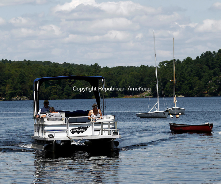 """Middlebury, CT- 20 July 2014-072014CM07-  Francis and Lucille McDonald of Waterbury, along with Andi Palomba of Waterbury return to the Lake Quassapaug Outing Club  on their 1992 Suncruise Pontoon boat, named """"The Big Windbag""""  in Middlebury on Sunday. According to the National Weather Service, Monday is expected to be sunny, with a high near 80.    Christopher Massa Republican-American"""