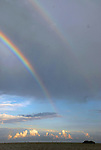 a double rainbow appears over the ocean off Plantation Key, Florida as late afternoon clouds gather ont the horizon