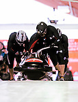 19 December 2010: Ethan Albrecht-Carrie leads his 4-Man Bobsled team in the push-off, taking 10th place for the USA at the Viessmann FIBT World Cup Championships on Mount Van Hoevenberg in Lake Placid, New York, USA. Mandatory Credit: Ed Wolfstein Photo