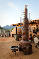&quot;Tequila Distillery&quot;- Tequila distillery and earthen agave oven used in the tequila and ricea making process. Photographed near San Sebastian, Mexico.