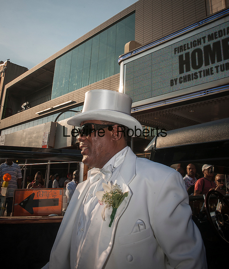 "Isaiah Owens, the owner of Owens Funeral Home, in Harlem in New York, arrives on Friday, June 21, 2013, at the Apollo Theater for a showing of Christine Turner's documentary film ""Homegoings"".  The film features Owens and his funeral home as it studies African-American traditions of death. Owens, who moved to New York in the 1960's, opened the funeral home and with just word of mouth and little advertising has become the paramount funeral home in Harlem, due to his care and understanding.  (© Richard B. Levine)"