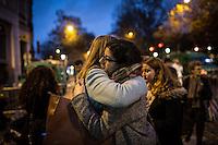 FRANCE, Paris: Women crying in front of the Bataclan as the police opened the acces after 3 days of investigation inside the place, November 17, 2015. People where displacing flowers, candles and words from the first gate to in front of the Bataclan where 89 people got killed by terrorists attacks. <br /> <br /> FRANCE, Paris: des jeunes femmes pleurent devant le Bataclan lorsque la police a ouvert les acces apres 3 jours d'enqu&ecirc;te &agrave; l'int&eacute;rieur du lieu, le 17 Novembre 2015. Les gens deplacaient fleurs, bougies et mots de la premi&egrave;re barriere vers l'avant du Bataclan, o&ugrave; 89 personnes ont ete tuees par des attaques terroristes.