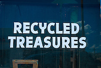 sign on a storefront window, &quot;recycled treasures&quot;