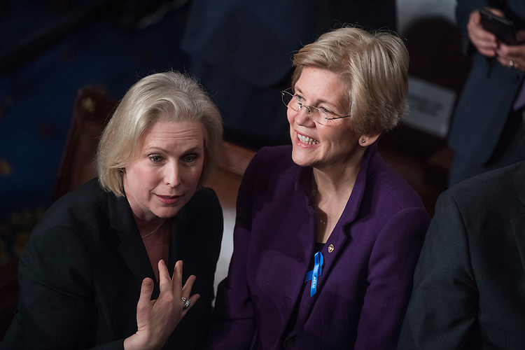 UNITED STATES - FEBRUARY 28: Sens. Elizabeth Warren, D-Mass., right, and Kirsten Gillibrand, D-N.Y., talk in the House Chamber before President Donald Trump addressed a joint session of Congress in the Capitol, February 28, 2017. (Photo By Tom Williams/CQ Roll Call)