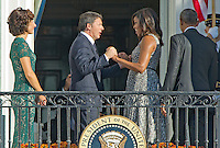 From left to right: Mrs. Agnese Landini; Prime Minister Matteo Renzi of Italy; first lady Michelle Obama; and United States President Barack Obama wave on the South Portico at the end of the Official Arrival Ceremony on the South Lawn of the the White House in Washington, DC on Tuesday, October 18, 2016.  <br /> Credit: Ron Sachs / CNP /MediaPunch