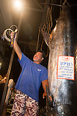 Bomboy LLanes poses with Pacific Blue Marlin Grander and a Bomboy Lure at the honokohau Harbour