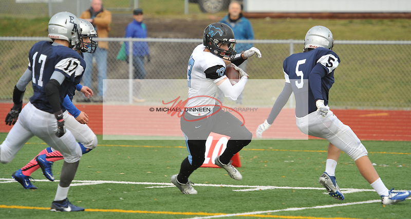 Chugiak's Jake Kindred cuts between Eagle River's Mke Thompson and Dawson Porter.  Photo for Star by Michael Dinneen