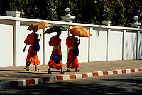 Although Vientiane is not known for its  temples and hundreds of monks wandering around, like Luang Prabang, it still has its share of strolling monks, coming and going from school, chanting ceremonies and early morning alms visits.