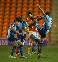 Blackpool's Armand Gnanduillet takes a boot to the face from Wycombe Wanderers' Will De Havilland<br /> <br /> Photographer Alex Dodd/CameraSport<br /> <br /> Checkatrade Trophy Round 3 Blackpool v Wycombe Wanderers - Tuesday 10th January 2017 - Bloomfield Road - Blackpool<br />  <br /> World Copyright &copy; 2017 CameraSport. All rights reserved. 43 Linden Ave. Countesthorpe. Leicester. England. LE8 5PG - Tel: +44 (0) 116 277 4147 - admin@camerasport.com - www.camerasport.com