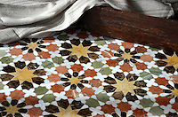Granada Grande, a natural stone waterjet mosaic shown in Emperador Dark, Verde Luna, Rojo Alicante, Calacatta Tia, Giallo Reale polished, is part of the Miraflores Collection by Paul Schatz for New Ravenna Mosaics.<br />