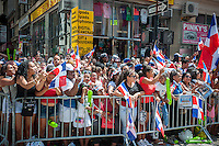 Thousands of Dominican-Americans and their friends and supporters march and view the Dominican Day Parade in New York on Sixth Avenue on Sunday, August 11, 2013.  Politicians, flags and cultural pride were on display at the annual event.  (© Richard B. Levine)