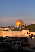 The golden Dome of the Rock reflects afternoon sunlight over the Western Wall and Temple Mount