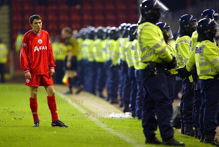 Riot cops at Pittodrie as Rangers visit on 19th Jan 2001. Derek Young looks worried