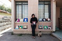 Artist Irma Nava in front of her house and studio in Reynosa, Mexico...La Frontera: Artists along the US Mexican Border. .www.stefanfalke.com..