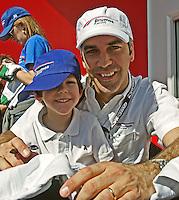 Driver Joao Barbosa nd his son at the Rolex 24 at Daytona , Daytona International Speedway, Daytona Beach, FL, January 2009.  )Photo by Brian Cleary)