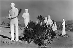 Joshua Tree, California USA 1969. On the edge of the National Park a former Hollywood sculptor who became a born again Christian depicts himself as Judas with Christ and his disciples..