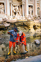 Rome 18 November 2006.The collected of coins thrown by tourists into the Trevi Fountain for express a wish is made by the staff of Caritas of Rome and used to finance the Emporio Caritas..Operation that takes place once a week.The fountain was built by the architect Salvi (1735) in the time of Pope Clement XII, and decorated by several artists of Bernini's school..La  raccolta delle monete gettate dai turisti dentro Fontana di Trevi per esprimere un desiderio viene effettuata dal personale della Caritas Diocesana di Roma  e servono a finanziare l?Emporio Caritas..Operazione che viene effettuata una volta a settimana.