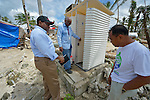John Nduna (left), the general secretary of the ACT Alliance, inspects temporary latrines in Bacubac, a neighborhood in Basey in the Philippines province of Samar that was hit hard by Typhoon Haiyan in November 2013. The storm was known locally as Yolanda. Accompanying Nduna is Leopold Sindayigaya (center), a water and sanitation advisor for Norwegian Church Aid, and Efrain Ancaha, the neighborhood captain. The ACT Alliance has been providing a variety of forms of assistance to survivors here, and Nduna and other ACT Alliance leaders spent several days in affected communities learning first hand about the network's emergency response and long-term plans for recovery and rehabilitation.