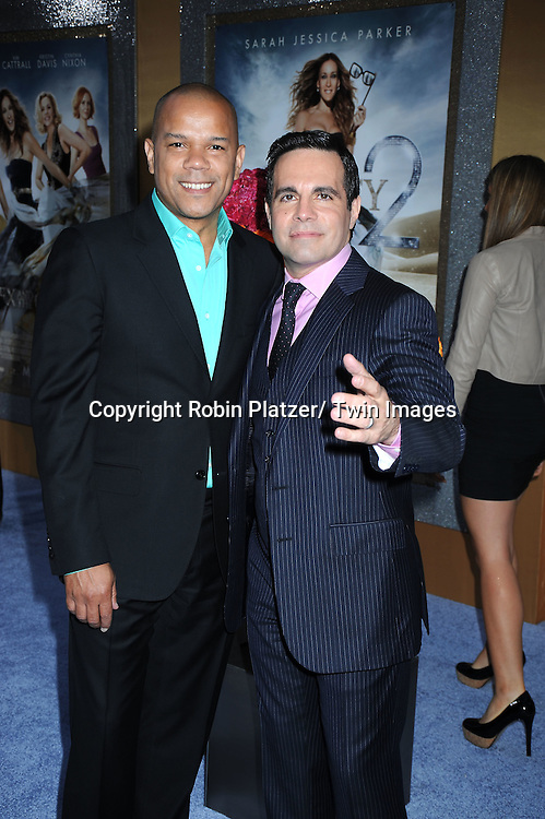 "Mario Cantone and boyfriend posing for photographers at the world premiere of ""Sex and the City 2"" on May 24, 2010 at Radio City Music Hall in New York City."