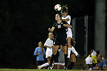09 October 2014: North Carolina's Joanna Boyles (right) heads the ball over Wake Forest's Claudia Day (18). The University of North Carolina Tar Heels hosted the Wake Forest University Demon Deacons at Fetzer Field in Chapel Hill, NC in a 2014 NCAA Division I Women's Soccer match. UNC won the game 3-0.