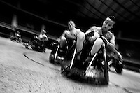 Cristian Amaya, a Colombian disabled athlete, grabs the ball during a wheelchair rugby training match at the indoor sporting arena Coliseo in Bogota, Colombia, 11 April 2013. Wheelchair rugby, a full-contact team sport, was developed in Canada in 1977 under the name murderball. The game is played only by athletes with some form of disability in both the upper and lower limbs (quadriplegics). Attempting to score by carrying the ball across the goal line, four players from each team roughly crash into each other in specially designed armored wheelchairs. Although the team from Bogota is supported by a foundation (gear), quad rugby players, mostly coming from the remote, socially deprived neighbourhoods, often can not attend a training due to lack of funds for transportation. However, they still dream of representing Colombia at Rio 2016 Paralympic Games.