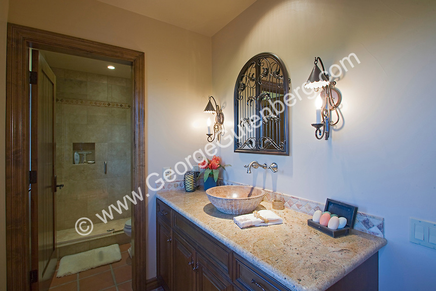 Travertine topped bathoom vanity with travertine bowl sink