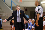 02 January 2014: UNC associate head coach Andrew Calder (left) complains to referee Jules Gallien. The University of North Carolina Tar Heels played the James Madison University Dukes in an NCAA Division I women's basketball game at Carmichael Arena in Chapel Hill, North Carolina.