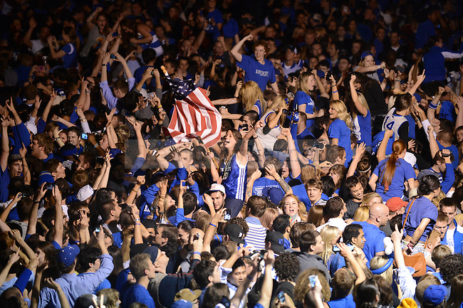 UK fans celebrate at the intersection of Woodland Ave. and Euclid Ave. in Lexington, Ky., after their victory over Kansas in the NCAA Basketball Championship game on 4/3/12. Photo by Mike Weaver   Staff